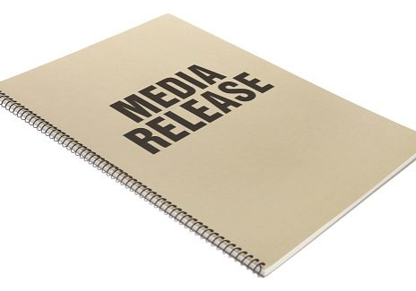Media Release bound business documents in book form with a kraft coloured cover - isolated on a white background.  Stock image of Paperwork Book on white.